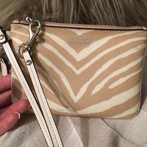 NWT Coach tan and cream zebra wristlet
